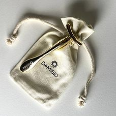 DAMIBIO masážní aplikátor T žluté zlato v dárkové taštičce